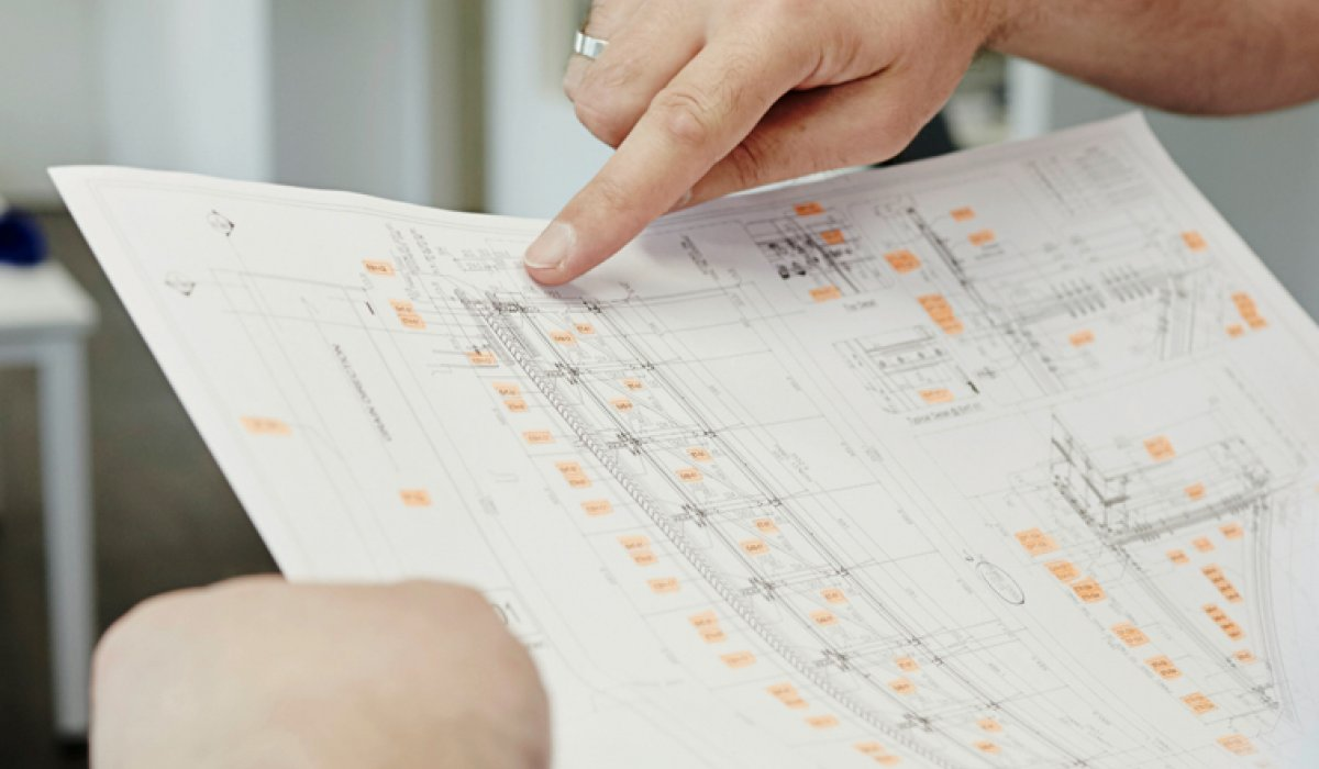 POHL employee shows technical drawing